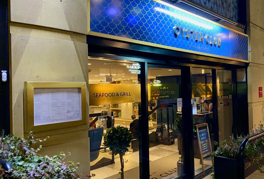 Gold and blue frontage of The Oyster Club Restaurant