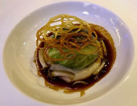 Cabbage leaf stuffed with guinea fowl in a mushroom jus and topped with a lattice of piped fried potato
